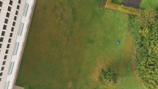 Belrobotic mowing in Office grounds